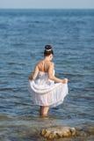 Девушка на море стоковые фото
