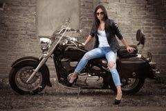 Девушка на мотоцикле Стоковые Изображения