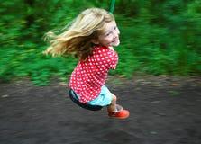 Девушка на проводе застежка-молнии стоковое фото