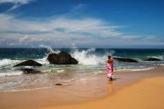 Девушка на пляже Стоковые Изображения
