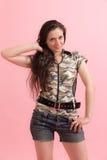 Девушка на розовой предпосылке Стоковые Фотографии RF