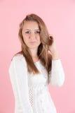 Девушка на розовой предпосылке Стоковая Фотография RF