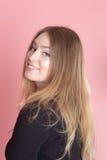 Девушка на розовой предпосылке Стоковые Фото
