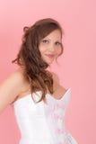 Девушка на розовой предпосылке Стоковая Фотография