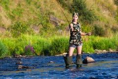 Девушка на рыбной ловле стоковые изображения