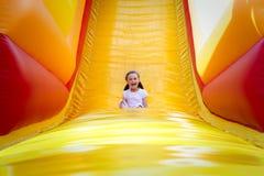 Девушка на скольжении Стоковая Фотография