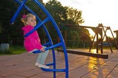 Девушка на спортивной площадке Стоковые Изображения RF