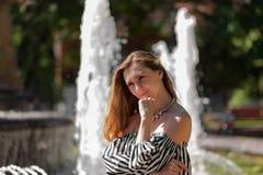 Девушка на фонтане Стоковое фото RF