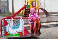 Девушка на carousel Стоковые Фото