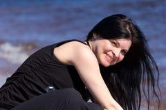 Девушка около воды Стоковые Изображения RF