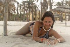 Девушка около пальм и песка Стоковое фото RF