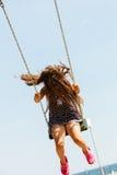 Девушка отбрасывая на набор качани Стоковые Изображения RF