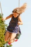 Девушка отбрасывая на набор качани Стоковые Изображения