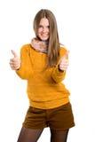 Девушка показывает 2 большого пальца руки Стоковое фото RF