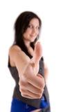 Девушка показывая большой пец руки вверх Стоковое фото RF