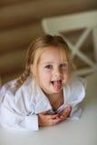 Девушка показывая язык Стоковые Изображения RF