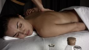 Девушка положила камни для массажа видеоматериал