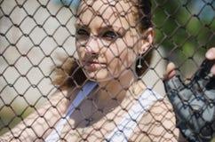 Девушка после решетки стоковое изображение rf