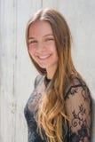Девушка подростка в черном платье Стоковое фото RF
