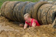 Девушка преодолевая препятствия Стоковая Фотография