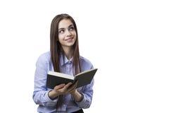 Девушка при изолированная книга Стоковые Изображения RF