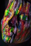 Девушка при покрашенная покрашенная сторона Изображение красоты искусства Стоковое фото RF