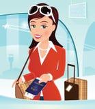 Девушка проверяя внутри на столе авиапорта Стоковое фото RF
