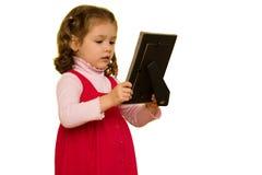 девушка рамки смотря детенышей изображения уныло Стоковая Фотография