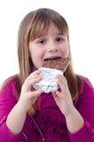 Девушка ребенка есть шоколад Стоковые Фотографии RF