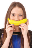 Девушка ребенка с улыбкой банана Стоковое Изображение RF