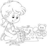 Девушка рисуя смешное изображение Стоковое Фото