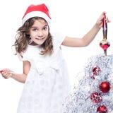 девушка рождества милая украшая меньший вал Стоковое Изображение RF