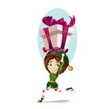Девушка рождества с волшебным эльфом бежит большой подарок Стоковые Фото