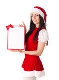 Девушка рождества с доской сзажимом для бумаги Стоковое фото RF
