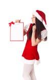 Девушка рождества с доской сзажимом для бумаги Стоковое Изображение RF