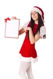Девушка рождества с доской сзажимом для бумаги Стоковая Фотография RF