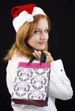 Девушка рождества с хозяйственными сумками Стоковое Изображение