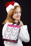 Девушка рождества с хозяйственными сумками Стоковое Фото