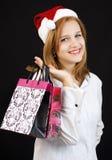 Девушка рождества с хозяйственными сумками Стоковая Фотография