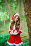 Девушка Санта Клауса азиата Стоковое Фото