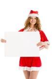 Девушка Санты держит большой горизонтальный чистый лист бумаги Стоковое фото RF