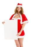 Девушка Санты держит вертикальный чистый лист бумаги Стоковая Фотография RF