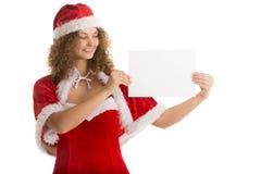 Девушка Санты держит малый горизонтальный чистый лист бумаги Стоковые Изображения