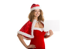 Девушка Санты держит малый горизонтальный чистый лист бумаги Стоковая Фотография RF