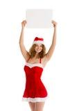 Девушка Санты задерживает чистый лист бумаги Стоковая Фотография