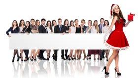 Девушка Санты и большая группа в составе бизнесмены Стоковая Фотография RF