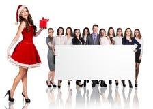 Девушка Санты и большая группа в составе бизнесмены Стоковые Фото