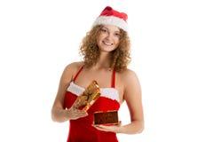 Девушка Санты раскрывает подарочную коробку Стоковые Изображения RF