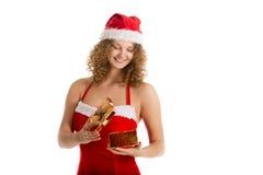 Девушка Санты смотрит в подарочную коробку Стоковое Изображение