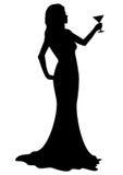 Девушка силуэта с стеклом коктеиля Стоковые Изображения RF